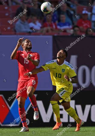 Stock Image of Panama defender Eric Davis and Guyana forward Emery Welshman look up for the ball during the first half of a CONCACAF Gold Cup soccer match, in Cleveland