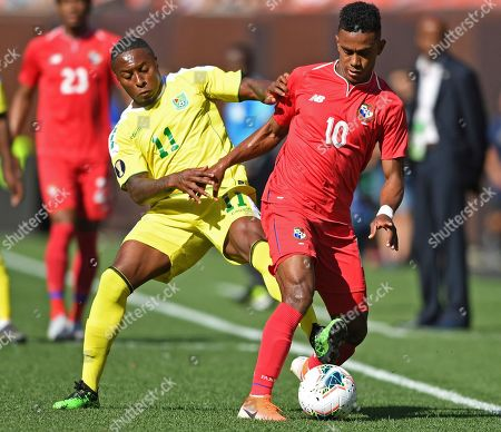 Guyana midfielder Callum Harriott grabs Panama midfielder Edgar Barcenas during the first half of a CONCACAF Gold Cup soccer match, in Cleveland