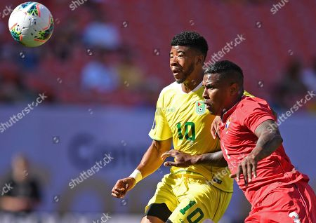 Stock Image of Guyana forward Emery Welshman and Panama defender Harold Cummings play the ball during the first half of a CONCACAF Gold Cup soccer match, in Cleveland