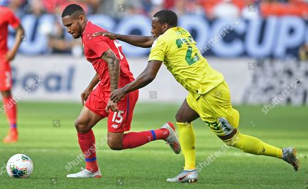 Panama defender Eric Davis works the ball in front of Guyana midfielder Anthony Jeffrey during the second half of a CONCACAF Gold Cup soccer match, in Cleveland. Panama won 4-2