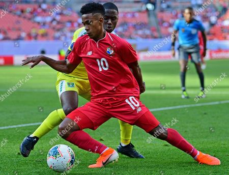 Panama midfielder Edgar Barcenas (10) plays the ball against Guyana defender Jordan Dover during the second half of a CONCACAF Gold Cup soccer match, in Cleveland. Panama won 4-2