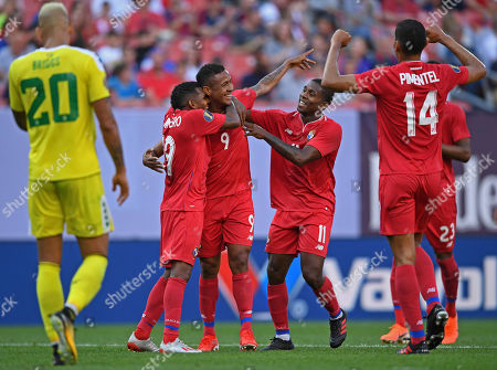 Stock Image of Panama forward Gabriel Torres, bottom, celebrates with midfielder Alberto Quintero and midfielder Armando Cooper after scoring a goal during the second half of a CONCACAF Gold Cup soccer match, in Cleveland. Panama won 4-2