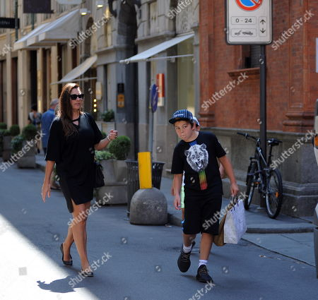 Stock Image of Alena Seredova with her children Louis Thomas of 11 and David Lee of 9 to go shopping.