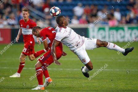 Real Salt Lake defender Nedum Onuoha, right, battles for the ball with Chicago Fire forward Nemanja Nikolic during the first half of an MLS soccer match, in Bridgeview, Ill