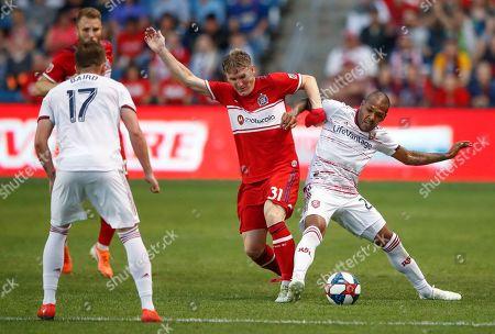 Chicago Fire midfielder Bastian Schweinsteiger (31) battles for the ball with Real Salt Lake midfielder Everton Luiz (25) during the first half of an MLS soccer match, in Bridgeview, Ill