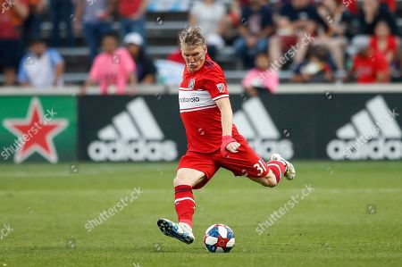 Stock Photo of Chicago Fire midfielder Bastian Schweinsteiger looks to kick the ball against Real Salt Lake during the first half of an MLS soccer match, in Bridgeview, Ill