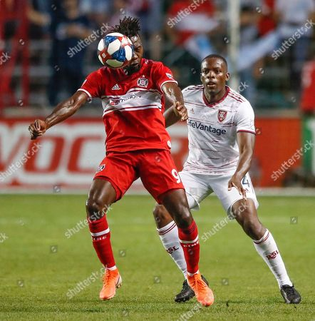 Chicago Fire forward C.J. Sapong (9) goes for a header against Real Salt Lake defender Nedum Onuoha (14) during the second half of an MLS soccer match, in Bridgeview, Ill