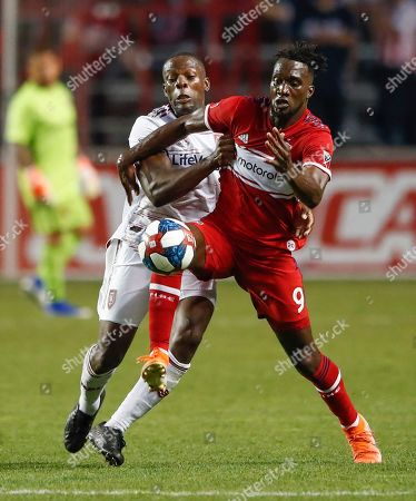 Chicago Fire forward C.J. Sapong, right, competes for the ball with Real Salt Lake defender Nedum Onuoha during the second half of an MLS soccer match, in Bridgeview, Ill