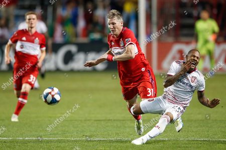 Chicago Fire midfielder Bastian Schweinsteiger (31) fouls Real Salt Lake midfielder Everton Luiz (25) during the second half of an MLS soccer match, in Bridgeview, Ill