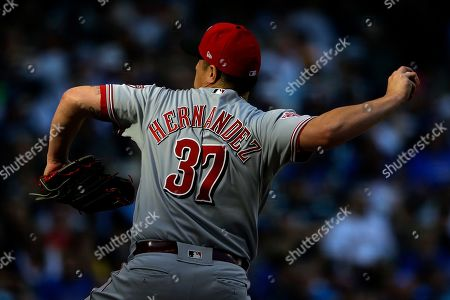 Cincinnati Reds' David Hernandez pitches during the eighth inning of a baseball game against the Milwaukee Brewers, in Milwaukee