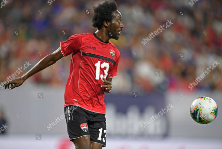 Trinidad and Tobago midfielder Nathan Lewis plays the ball during the second half of a CONCACAF Gold Cup soccer match against the the United States, in Cleveland. The United States won 6-0