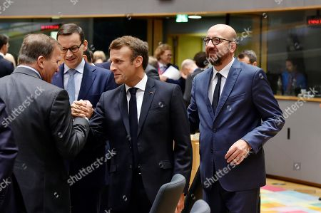 Denmark's Prime Minister Lars Lokke Rasmussen, French President Emmanuel Macron and Belgium's Prime Minister Charles Michel