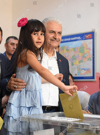 Turkish ruling party Justice and Development Party (AKP) candidate for Istanbul mayor, Binali Yildirim casts his vote with his grandchild during the Istanbul mayoral elections re-run, in Istanbul, Turkey, 23 June 2019. Some 10.5 million people will vote on the day in a re-run of the mayoral election. The Turkish Electoral Commission ordered a repeat of the mayoral election in Istanbul for 23 June 2019, after Turkish President Erdogan's AK Party had alleged there was 'corruption' behind his party losing in the 31 March 2019 polls.