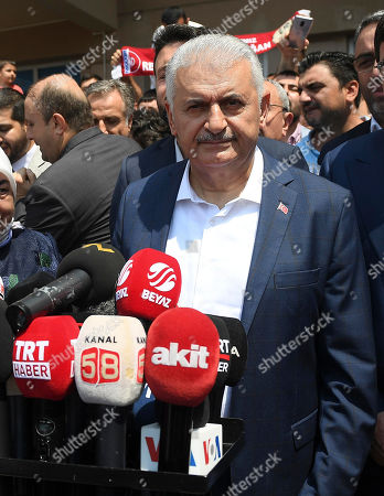 Turkish ruling party Justice and Development Party (AKP) candidate for Istanbul mayor, Binali Yildirim speaks to the media after casting his vote in the Istanbul mayoral elections re-run, in Istanbul, Turkey, 23 June 2019. Some 10.5 million people will vote on the day in a re-run of the mayoral election. The Turkish Electoral Commission ordered a repeat of the mayoral election in Istanbul for 23 June 2019, after Turkish President Erdogan's AK Party had alleged there was 'corruption' behind his party losing in the 31 March 2019 polls.