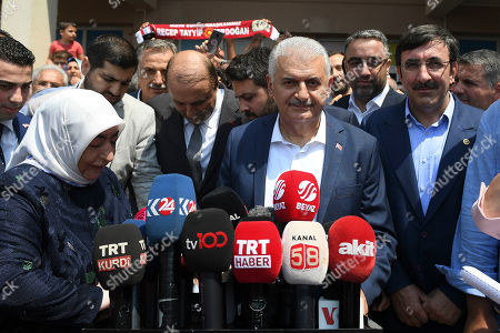 Turkish ruling party Justice and Development Party (AKP) candidate for Istanbul mayor, Binali Yildirim (C), next to his wife Semiha Yildirim (L), speaks to the media after casting his vote in the Istanbul mayoral elections re-run, in Istanbul, Turkey, 23 June 2019. Some 10.5 million people will vote on the day in a re-run of the mayoral election. The Turkish Electoral Commission ordered a repeat of the mayoral election in Istanbul for 23 June 2019, after Turkish President Erdogan's AK Party had alleged there was 'corruption' behind his party losing in the 31 March 2019 polls.
