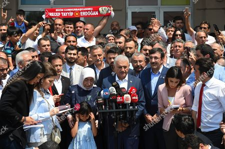 Turkish ruling party Justice and Development Party (AKP) candidate for Istanbul Mayor Binali Yildirim (C), next to his wife Semiha Yildirim (C-L), speaks to the media after casting his vote in the Istanbul mayoral elections re-run, in Istanbul, Turkey, 23 June 2019. Some 10.5 million people will vote on the day in a re-run of the mayoral election. The Turkish Electoral Commission ordered a repeat of the mayoral election in Istanbul for 23 June 2019, after Turkish President Erdogan's AK Party had alleged there was 'corruption' behind his party losing in the 31 March 2019 polls.