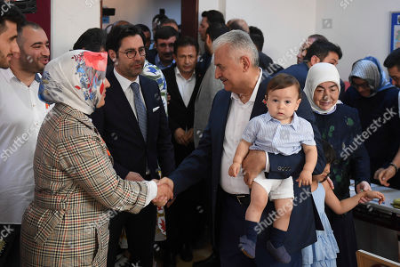 Turkish ruling party Justice and Development Party (AKP) candidate for Istanbul Mayor Binali Yildirim (C), with his grandson, arrives to cast his vote in the Istanbul mayoral elections re-run, in Istanbul, Turkey, 23 June 2019. Some 10.5 million people will vote on the day in a re-run of the mayoral election. The Turkish Electoral Commission ordered a repeat of the mayoral election in Istanbul for 23 June 2019, after Turkish President Erdogan's AK Party had alleged there was 'corruption' behind his party losing in the 31 March 2019 polls.