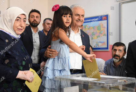 Turkish ruling party Justice and Development Party (AKP) candidate for Istanbul mayor, Binali Yildirim (R) casts his vote with his wife Semiha Yildirim (L) and his grandchild during the Istanbul mayoral elections re-run, in Istanbul, Turkey, 23 June 2019. Some 10.5 million people will vote on the day in a re-run of the mayoral election. The Turkish Electoral Commission ordered a repeat of the mayoral election in Istanbul for 23 June 2019, after Turkish President Erdogan's AK Party had alleged there was 'corruption' behind his party losing in the 31 March 2019 polls.