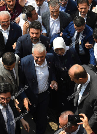 Turkish ruling party Justice and Development Party (AKP) candidate for Istanbul Mayor Binali Yildirim (C) and his wife Semiha Yildirim (C-R) arrive to vote in the Istanbul mayoral elections re-run, in Istanbul, Turkey, 23 June 2019. Some 10.5 million people will vote on the day in a re-run of the mayoral election. The Turkish Electoral Commission ordered a repeat of the mayoral election in Istanbul for 23 June 2019, after Turkish President Erdogan's AK Party had alleged there was 'corruption' behind his party losing in the 31 March 2019 polls.