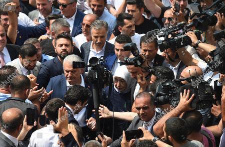 Turkish ruling party Justice and Development Party (AKP) candidate for Istanbul Mayor Binali Yildirim (C-L) and his wife Semiha Yildirim (C-R) arrive to vote in the Istanbul mayoral elections re-run, in Istanbul, Turkey, 23 June 2019. Some 10.5 million people will vote on the day in a re-run of the mayoral election. The Turkish Electoral Commission ordered a repeat of the mayoral election in Istanbul for 23 June 2019, after Turkish President Erdogan's AK Party had alleged there was 'corruption' behind his party losing in the 31 March 2019 polls.