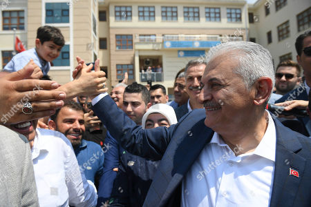 Turkish ruling party Justice and Development Party (AKP) candidate for Istanbul Mayor Binali Yildirim greets to people after cast his vote during the Istanbul mayoral elections re-run, in Istanbul, Turkey, 23 June 2019. Some 10.5 million people will vote on the day in a re-run of the mayoral election. The Turkish Electoral Commission ordered a repeat of the mayoral election in Istanbul for 23 June 2019, after Turkish President Erdogan's AK Party had alleged there was 'corruption' behind his party losing to a candidate of main opposition Republican People's Party's (CHP) in the 31 March 2019 polls.