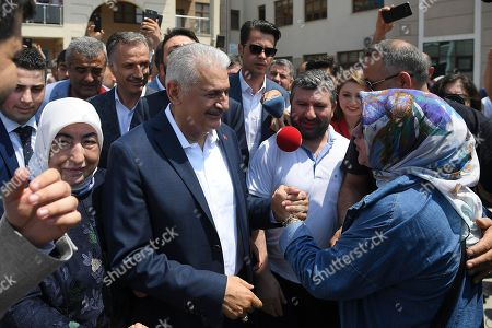 Turkish ruling party Justice and Development Party (AKP) candidate for Istanbul Mayor Binali Yildirim (C) greets to people after cast his vote with his wife Semiha Yildirim (L) during the Istanbul mayoral elections re-run, in Istanbul, Turkey, 23 June 2019. Some 10.5 million people will vote on the day in a re-run of the mayoral election. The Turkish Electoral Commission ordered a repeat of the mayoral election in Istanbul for 23 June 2019, after Turkish President Erdogan's AK Party had alleged there was 'corruption' behind his party losing to a candidate of main opposition Republican People's Party's (CHP) in the 31 March 2019 polls.