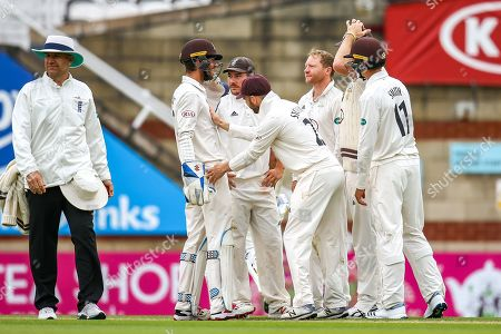 Wicket! Gareth Batty of Surrey and Ben Foakes of Surrey celebrate taking the wicket of Jeetan Patel of Warwickshire during the Specsavers County Champ Div 1 match between Surrey County Cricket Club and Warwickshire County Cricket Club at the Kia Oval, Kennington