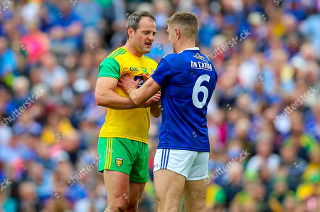 Stock Photo of Cavan vs Donegal. Cavan's Killian Clarke with Michael Murphy of Donegal