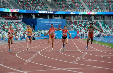 (L-R) Inna Eftimova of Bulgaria, Hrystyna Stuy of Ukraine, Estela Garcia of Spain, Mizgin Ay of Turkey, Lorene Bazolo of Portugal cross finish line at Women's 100m qualification round at Dynamic New Athletics at Dinamo Stadium at the Minsk 2019 European Games in Minsk, Belarus, 23 June 2019. The 2019 European Games will be held in Belarus from 21 to 30 June 2019.