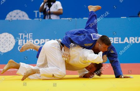 Stock Image of Attila Ungvari (blue) of Hungary and Alexander Wieczerzak of Germany compete in the men's -81 kg bronze medal contest of the Judo competitions at the Minsk 2019 European Games in Minsk, Belarus, 23 June 2019.