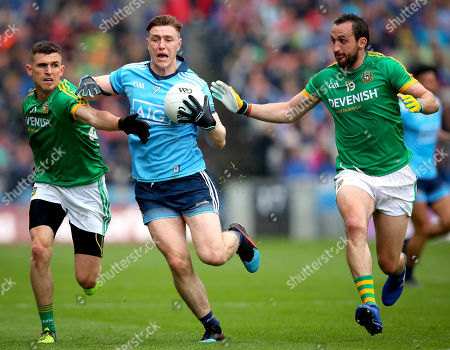 Dublin vs Meath. Dublin's John Small with Graham Reilyy and Shane McEntee of Meath