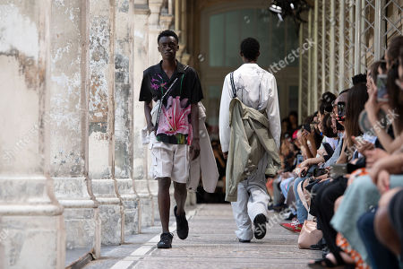 Stock Photo of Models present creations from the Spring/Summer 2020 Men's collection by Japanese designer Masanori Morikawa for Christian Dada during the Paris Fashion Week, in Paris, France, 23 June 2019. The presentation of the Spring/Summer 2020 menswear collections runs from 18 to 23 June 2019.