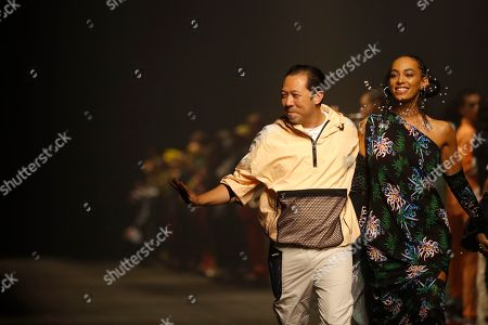 Stock Photo of Solange Knowles, Kenzo Takada. Designer Kenzo Takada, left, accepts applause as he walks with singer Solange Knowles after the Kenzo mens Spring-Summer 2020 fashion collection presented in Paris