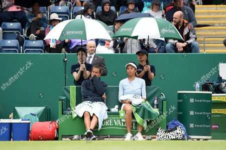 Su-Wei Hsieh of Chinese Taipei and Barbora Strycova of the Czech Republic sit under umbrellas as the rain comes down during the Womens doubles final match against Anna-Lena Groenefeld of Germany and Demi Schuurs of the Netherlands.