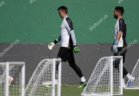 Uruguay's goalkeepers Fernando Muslera, left, and Martin Campana attend a practice session in Rio de Janeiro, Brazil, . Uruguay will face Chile on June 24, in a Copa America Group C soccer match
