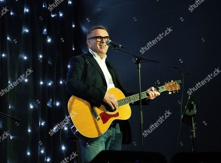 Stock Image of Picture shows Chris Difford, founder member of Squeeze, playing a Solo acoustic gig.