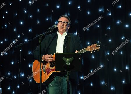 Stock Photo of Picture shows Chris Difford, founder member of Squeeze, playing a Solo acoustic gig.