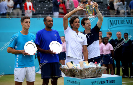 Andy Murray of Great Britain celebrates with Feliciano Lopez of Spain with their trophies next to Joe Salisbury of GBR and Rajeev Ram of USA