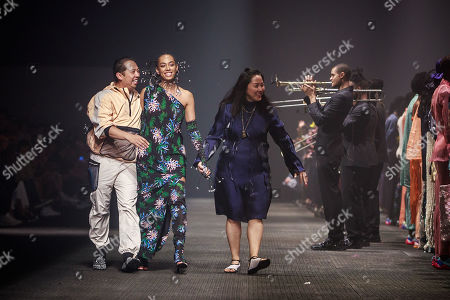 Stock Picture of US singer Solange Knowles appears on the runway surrounded by designers Humberto Leon and Carol Lim after the presentation of their Spring/Summer 2020 Men's and women's collection  for Kenzo during the Paris Fashion Week, in Paris, France, 23 June 2019. The presentation of the Spring/Summer 2020 menswear collections runs from 18 to 23 June.