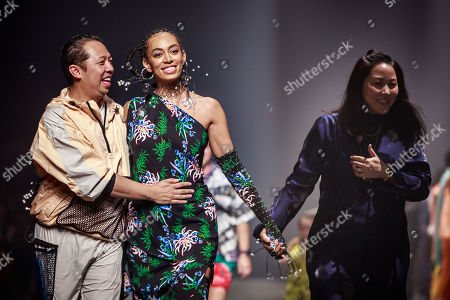 Stock Image of US singer Solange Knowles appears on the runway surrounded by designers Humberto Leon and Carol Lim after the presentation of their Spring/Summer 2020 Men's and women's collection  for Kenzo during the Paris Fashion Week, in Paris, France, 23 June 2019. The presentation of the Spring/Summer 2020 menswear collections runs from 18 to 23 June.