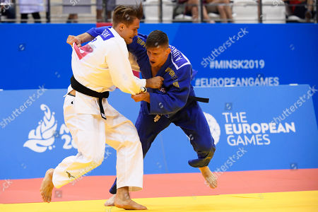 Stock Photo of Attila Ungvari (blue) of Hungary and Alexander Wieczerzak of Germany in action during the bronze medal bout of the men's 81kg Judo category at the Minsk 2019 European Games in Minsk, Belarus, 23 June 2019.