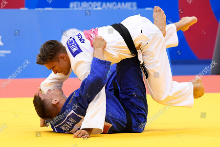 Attila Ungvari (blue) of Hungary and Alexander Wieczerzak of Germany in action during the bronze medal bout of the men's 81kg Judo category at the Minsk 2019 European Games in Minsk, Belarus, 23 June 2019.