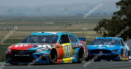 Kyle Busch, Ryan Blaney. Kyle Busch, left, leads Ryan Blaney (12) during a NASCAR Sprint Cup Series auto race, in Sonoma, Calif