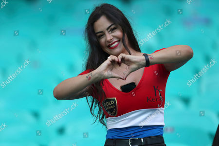 Paraguay's soccer fan Larissa Riquelme poses for photos prior to a Copa America Group B soccer match between Colombia and Paraguay at the Arena Fonte Nova in Salvador, Brazil