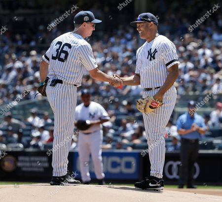 Mariano Rivera, David Cone. Former New York Yankees Mariano Rivera, right, and David Cone shake hands on the mound during the Old Timer's Day game at Yankee Stadium, in New York