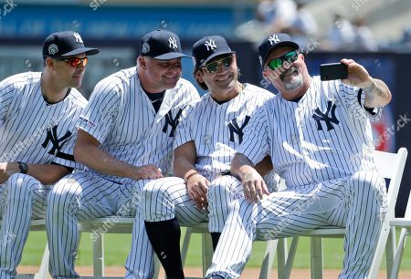 David Wells, Johnny Damon, Jason Giambi, Aaron Boone. Former New York Yankee David Wells, right, takes a selfie with Johnny Damon, second from right, Jason Giambi, second from left, and current manager Aaron Boone during Old Timer's Day at Yankee Stadium, in New York