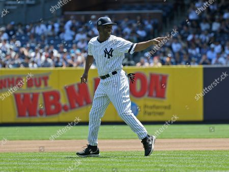 Former New York Yankee Mickey Rivers is introduced during Old Timer's Day at Yankee Stadium, in New York