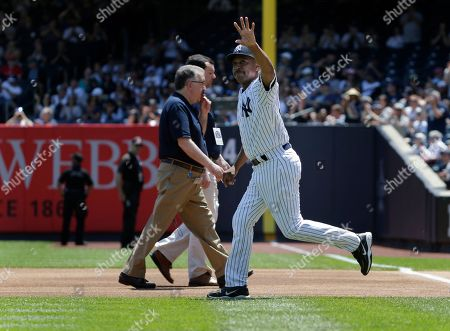 Stock Photo of Former New York Yankee Willie Randolph is introduced during Old Timer's Day at Yankee Stadium, in New York