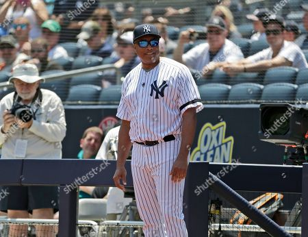 Stock Image of Former New York Yankee Bernie Williams is introduced during Old Timer's Day at Yankee Stadium, in New York