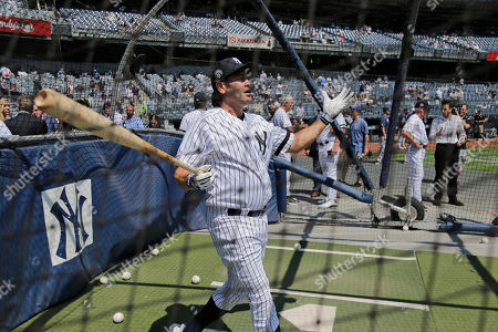 Former New York Yankee Johnny Damon takes batting practice during Old Timer's Day at Yankee Stadium, in New York